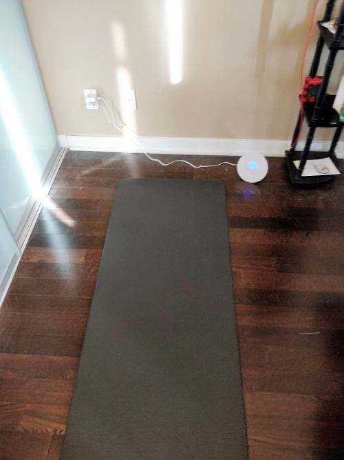 Minimalist yoga mat sleeping in small condo
